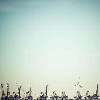 Germany, Hamburg, Harbour, cranes and wind wheels, copy space - KRPF001712