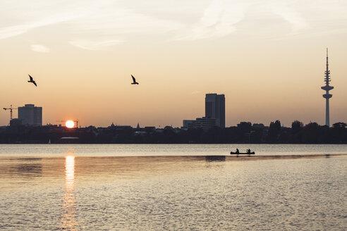 Germany, Hamburg, Outer Alster Lake at sunset, Heinrich-Hertz Tower right - KRPF001718