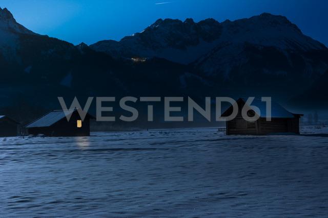 Austria, Tyrol, Lermoos, barn in snow at night - AMF004750