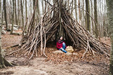 Spain, Barcelona, Santa Fe del Montseny, woman sitting in a hut having a rest - GEMF000715