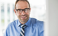 Portrait of smiling businessman - UUF006525