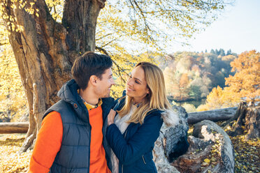 Happy couple enjoying autumn in a forest - CHAF001575