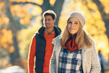 Happy couple enjoying autumn in a park - CHAF001599