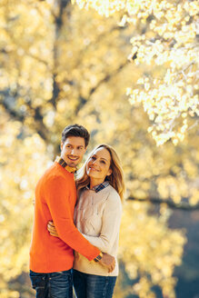 Happy couple enjoying autumn in a forest - CHAF001605