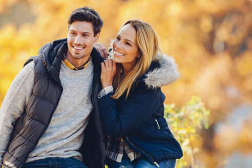 Happy couple enjoying autumn in a forest - CHAF001614