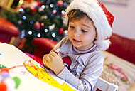 Portrait of little girl tinkering Christmas decoration - MGOF001352