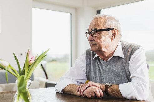 Senior man sitting at his living room - UUF006577