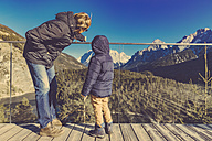 Father and son looking at Zugspitze from Biberwier, Tirol, Austria - MFF002626