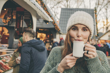 Woman having a hot punch on the Christmas Market - MFF002676