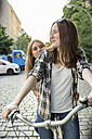 Two teenage girls together on a bicycle - OJF000109