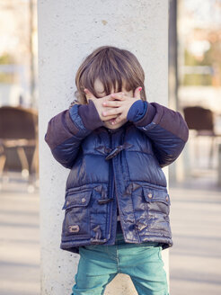 Little boy covering face with his hands - XCF000059