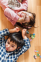 Boy and girl lying on the floor - MGOF001419