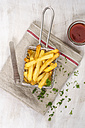 Deep-fried french fries in chip basket, ketchup - ODF001376
