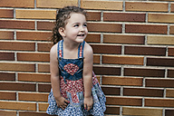 Portrait of smiling little girl wearing patterned summer dress - ERLF000132