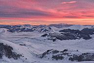 Italy, Umbria, Monti Sibillini National Park, Sunset on plateau Piano Grande of Castelluccio di Norcia  in Winter - LOMF000221