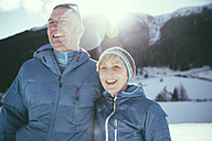 Italy, Val Venosta, Slingia, happy mature couple in winter landscape - MFF002722