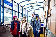 Three happy friends at train station - HAPF000218