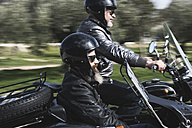 Two bikers driving with their sidecar motorcycle - JASF000408