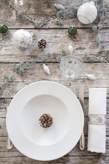 Place setting on laid table at Christmas time - LVF004524