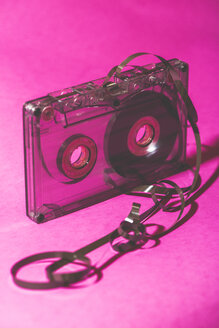 Transparent tangled-up tape on pink ground - DEGF000612