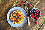 Waffle with blueberries and raspberries on plate - SARF002562