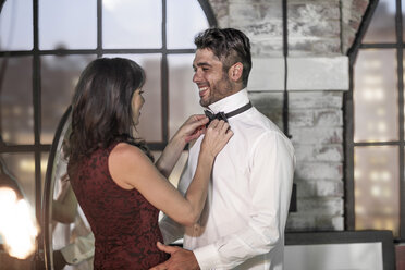 Couple in elegant clothing getting dressed - ZEF008450