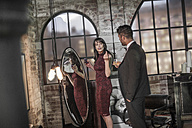 Well-dressed couple in an apartment - ZEF008453