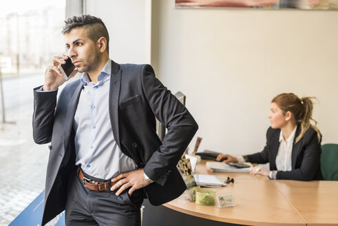 Businessman on the phone in office - JASF000447
