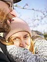 Young couple enjoying winter sun - LAF001609