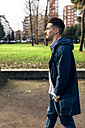 Spain, Gijon, young man walking in the park - MGOF001447