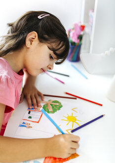 Little girl drawing on his desk at home - MGOF001453
