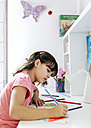 Little girl drawing on his desk at home - MGOF001456