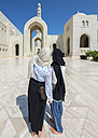Oman, Muscat, Sultan Qaboos Grand Mosque, two female tourists with headscarf - AMF004787