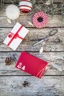 Christmas decoration and wrapped presents on wood - LVF004545