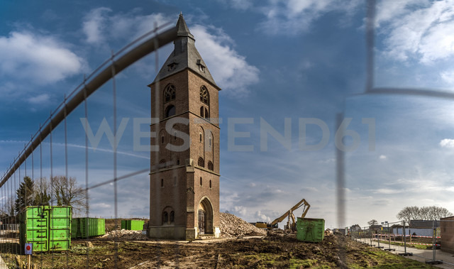 Germany, Borschemich, Tower of a church, gap in site fence - FRF000387 - Frank Röder/Westend61