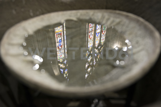 UK, Wales, Ludlow,  Church windows reflected in holy water of St Laurence's Church - SH001873