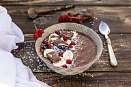 Bowl of banana chocolate smoothie with red currants and grated coconut - SARF002565