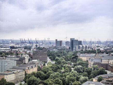 Germany, Hamburg, cityscape with Koehlbrand bridge and harbor cranes - KRPF001732
