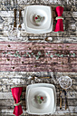Two place settings on laid table at Christmas time - SARF002568