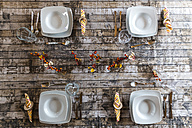 Four place settings on autumnal decorated table - SARF002571