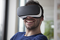 Smiling man wearing Virtual Reality Glasses - RBF004088