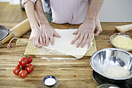 Couple preparing dough together - FMKF002394