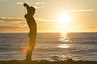 Surfer at sunrise on the beach - SKCF000066