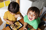 Two little brothers playing with digital tablet - VABF000180