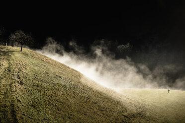 Germany, Bavaria, Berchtesgadener Land, mountain, boy on meadow in winter - MJF001743
