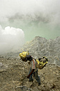 Indonesia, Java, Sulphur miners working in the crater at Kawah Ijen - DSG000983