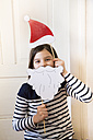Portrait of girl with Christmas cap and Father Christmas beard - LVF004573