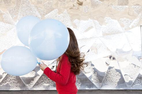 Little girl's face covered by light blue balloon - VABF000221