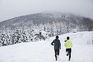 Couple doing cross country run in winter - HAPF000249