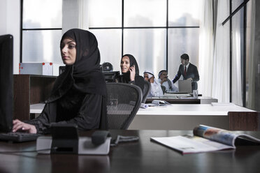 Middle Eastern businesswomen working in office - ZEF008578